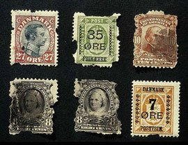 Sølvkræ har gnavet i disse frimærker